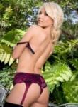 Art Lingerie blonde in purple lingerie gets naked but leaves on the stockings.