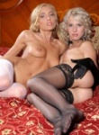 Art Lingerie two hot blondes get naked on the bed and kiss.