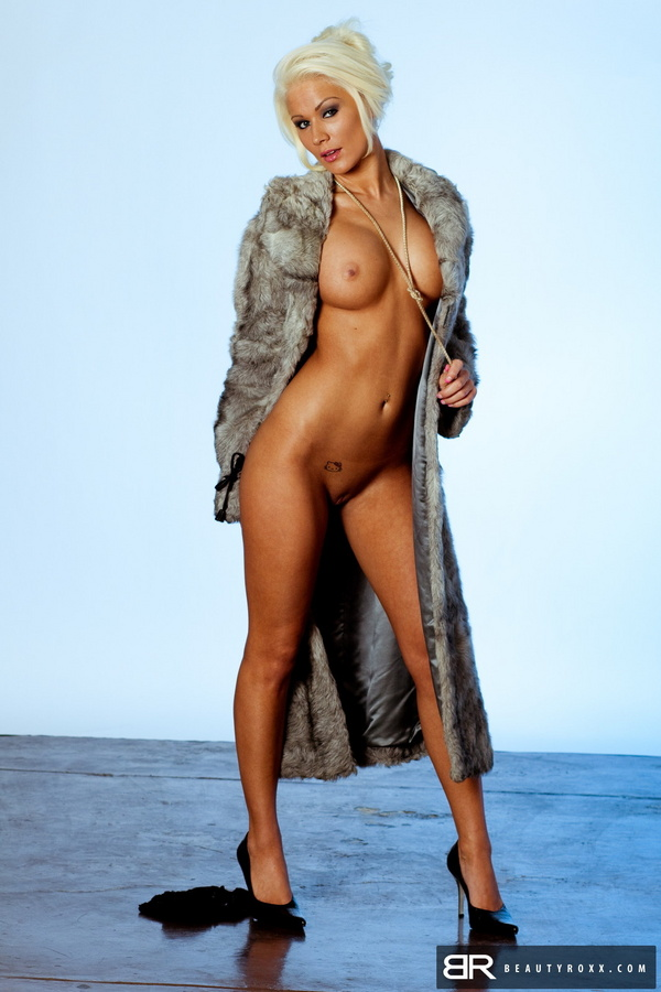 Naked women in fur coat really