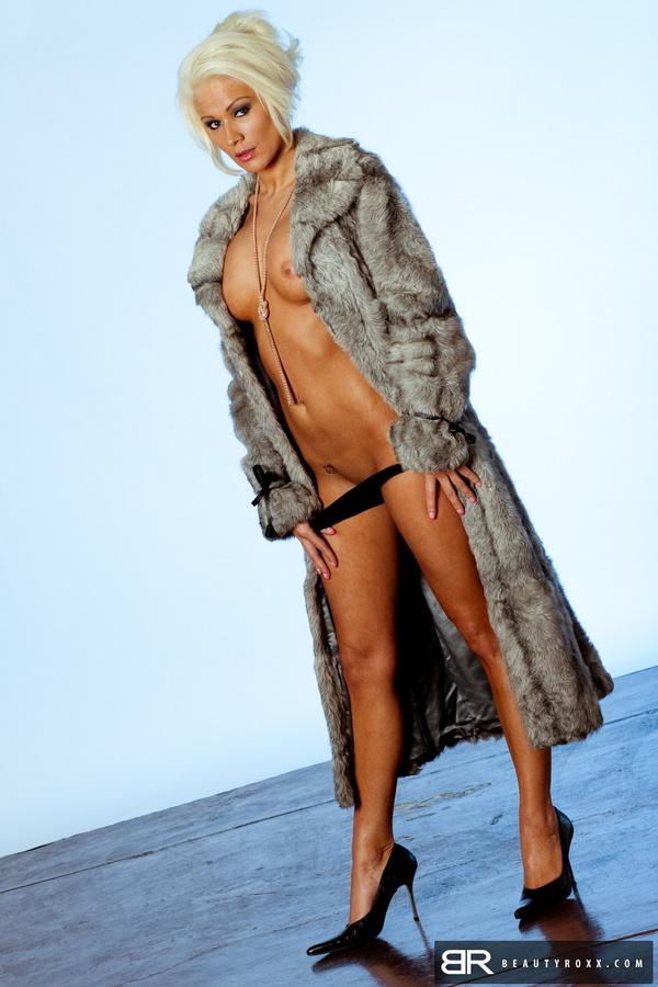 Nude woman in coat