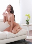 Sexy girl Jenna Sativa stripping naked and sucking a dildo