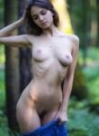 Lara Masier gets naked in the woods and shows off her hairy pussy in the process