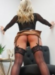 Madden shows off her sexy legs in black stockings and heels