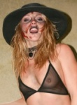 Madden the slutty zombie teases her boobs in a mesh bar as you can see her nipple through it