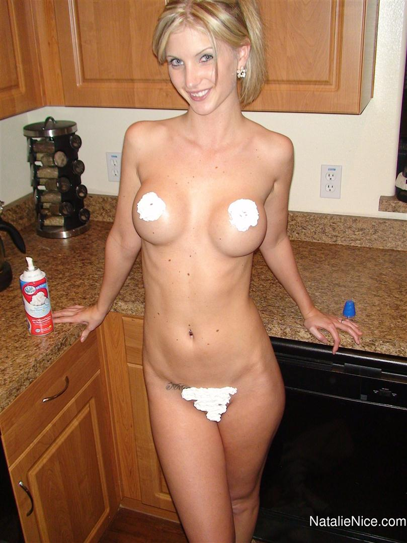 Natalie Nice covers her nipples and pussy in whip cream.