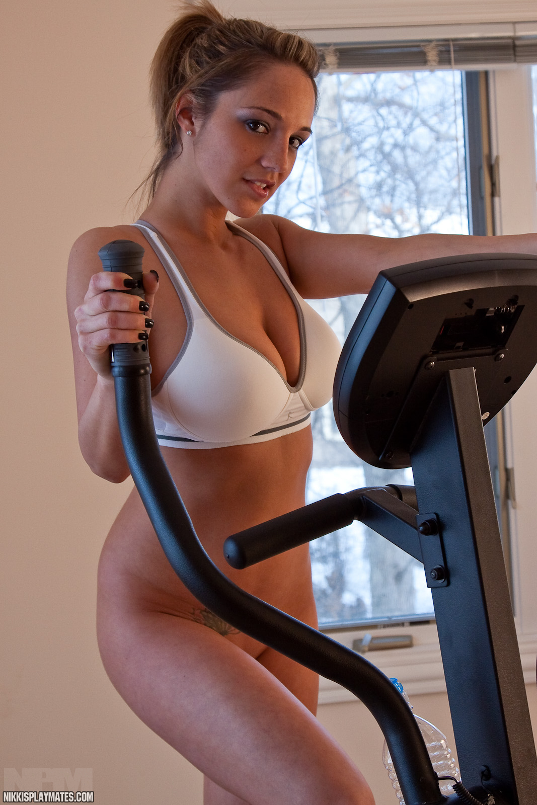 Sexy naked girl working out