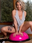 Nikki gives her pussy a work out on the yoga ball