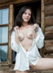 Pretty brunette eveda strips naked when she is out at the wood cabin