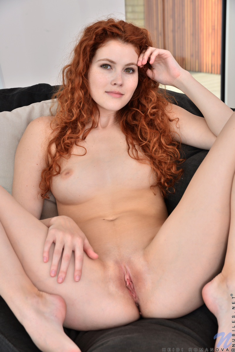 Sexy redhead teases on web cam stockings 8