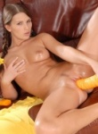 TeenModels babe fucks herself with a big yellow toy.