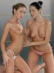 Teen Models Viki and friend get naked and touchie in the pool.