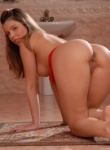 TeenModels babe Peaches stuffs her pussy with a big red dildo.