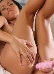 TeenModels tan petite teen Sonia toys her little pussy with a big pink vibrator.